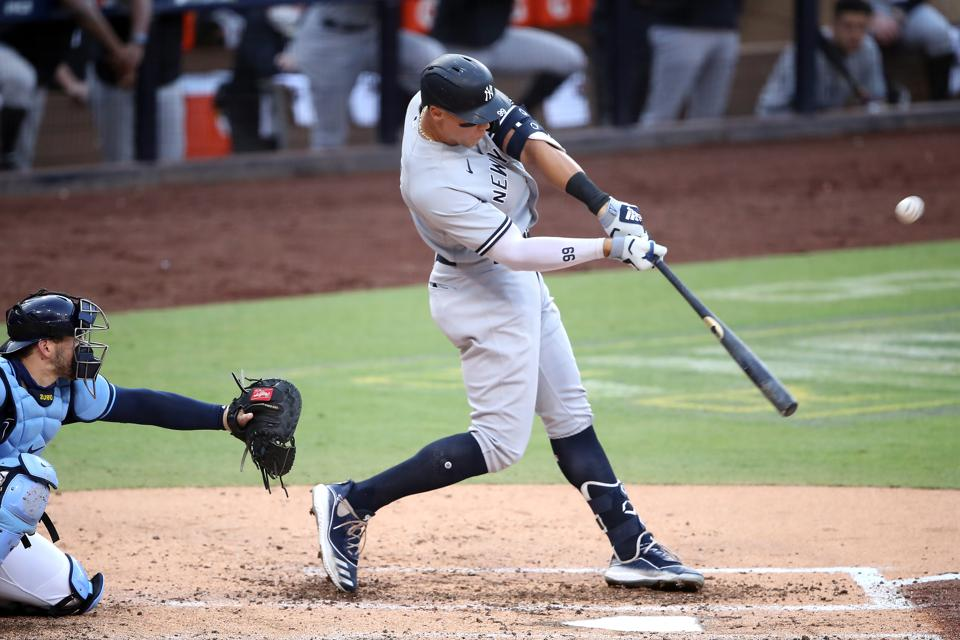 Right-handed hitter Aaron Judge hits a solo home run against Tampa Bay Rays.