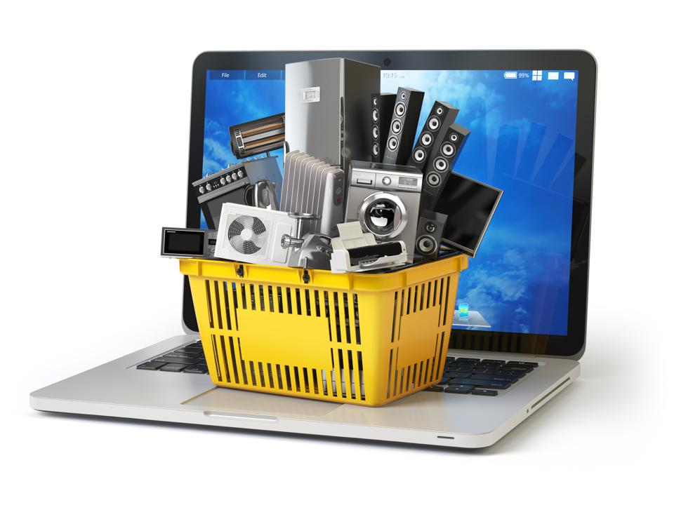 Home appliance in shopping cart on the laptop keyboard