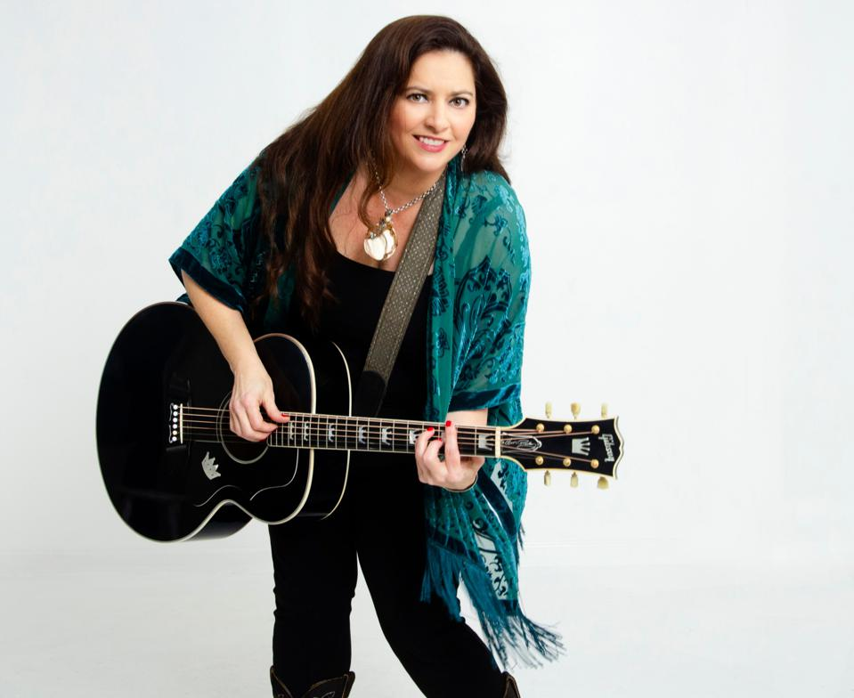 Shelley King with her guitar