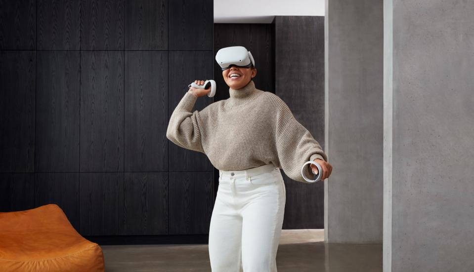A woman playing with the Oculus Quest 2 is a trendy-looking room.