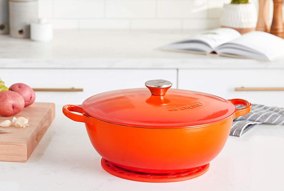 Le Creuset Enameled Cast Iron Curved Round Chef's Oven with Silicone French Trivet, 4.5 qt., Flame