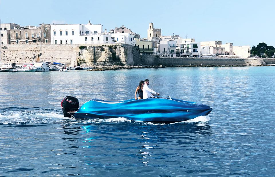 A couple sail the Mambo 3D-printed powerboat