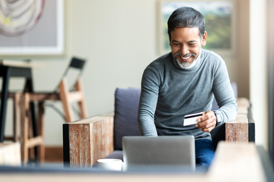 Attractive bearded hipster asian father or Hispanic old man using Laptop and credit card payment shopping online with customer network connection via...</p></div>    <div class=
