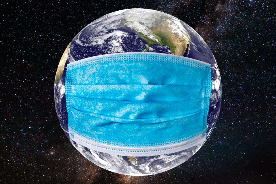 Planet earth with a medical mask. World epidemic concept