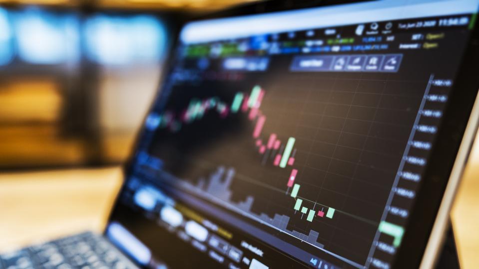 Laptop showing stock market data