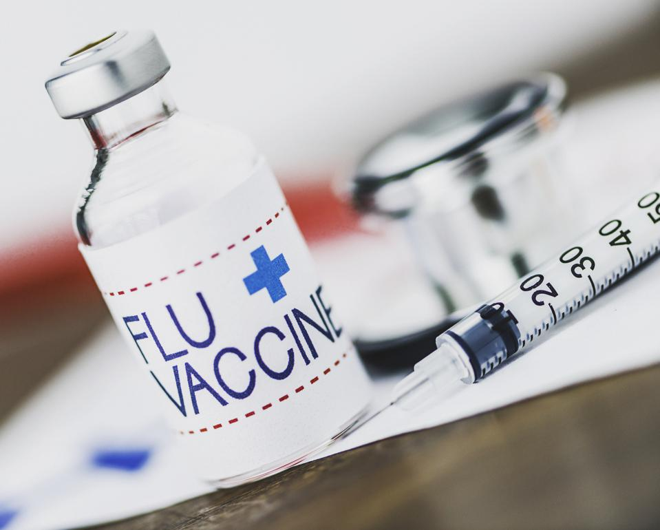 Flu vaccine with syringe and stethoscope