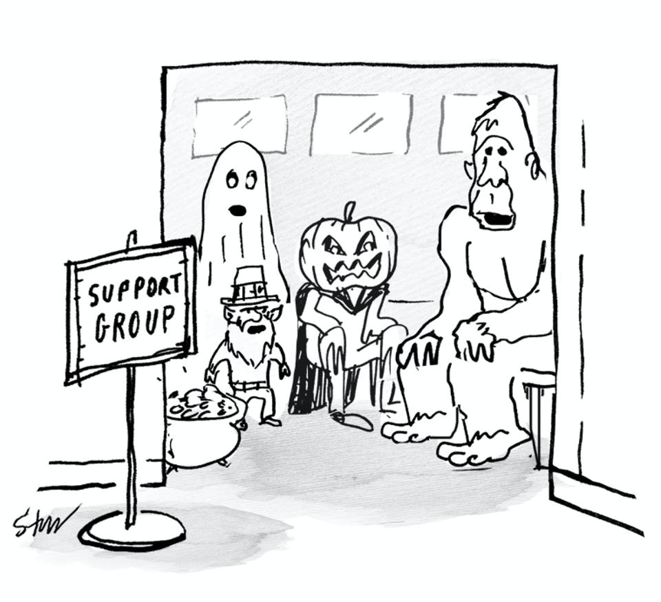 Stickman style cartoon of a leprechaun, bigfoot, ghost, and pumpkin head-ed villain sitting in a room with a sign at the entrance that reads ″support group″