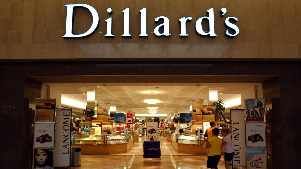 Shoppers enter the Dillard's store at the Broward Mall in Plantation, Florida, on Wednesday, August 20, 2003. Dillard's Inc. had a second-quarter loss of $50.4 million as sales fell after the 65-year-old department-store company reduced prices to try to keep shoppers from going to discounters and retailers such as Kohl's Corp.Shares of Dillard's declined as much as 13 percent. Photographer: Richard Sheinwald/Bloomberg News