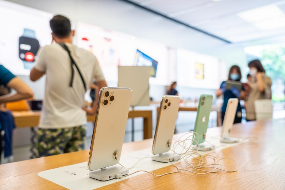 iPhone 11 series smartphones displayed at an Apple retail...
