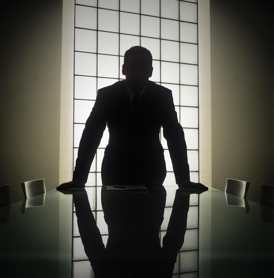 Business man or boss in silhouette interview showing bad boss