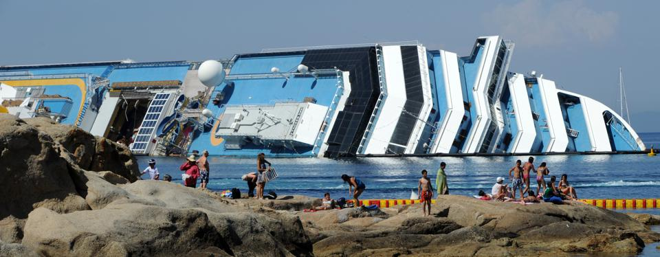 View Of The Wreckage Of Capsized Cruise Liner Costa Concordia At Giglio Island