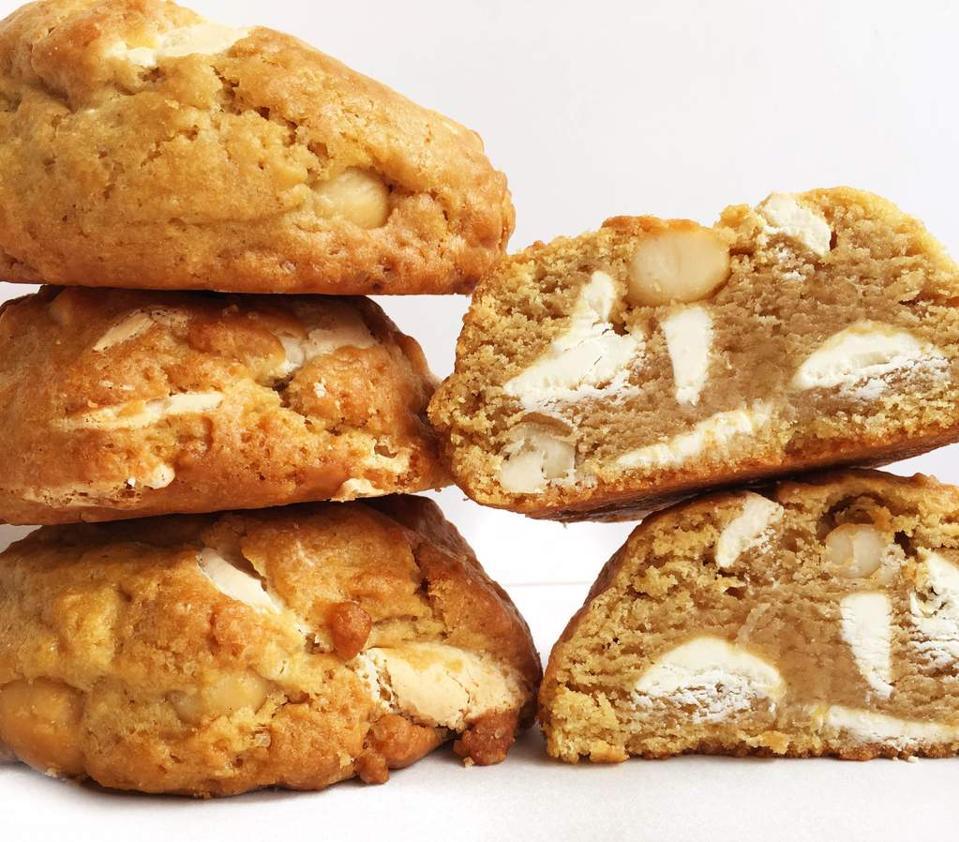 Five thick white chocolate macadamia nut cookies