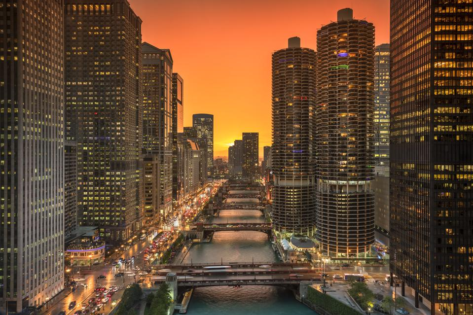 Chicago cityscape and bridges over the river at night