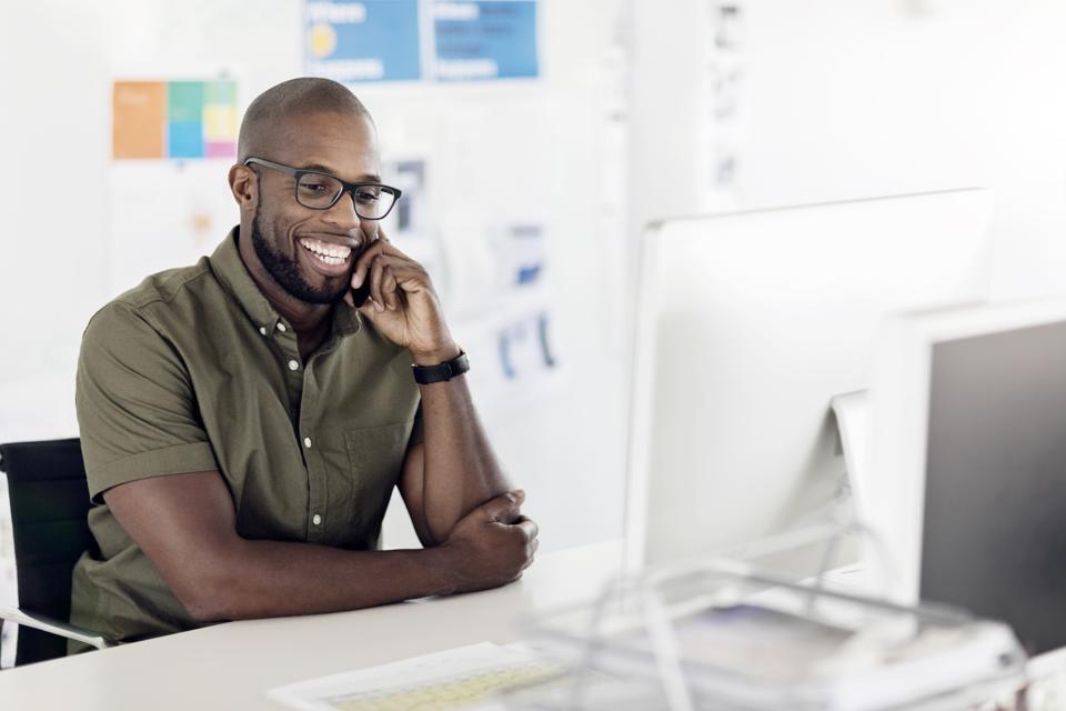 Smiling businessman at desk in office