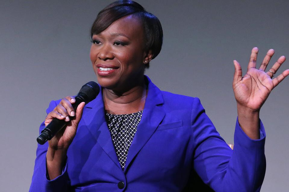 MSNBC host, Joy Reid, speaks at a conference. Her mother died of breast cancer.