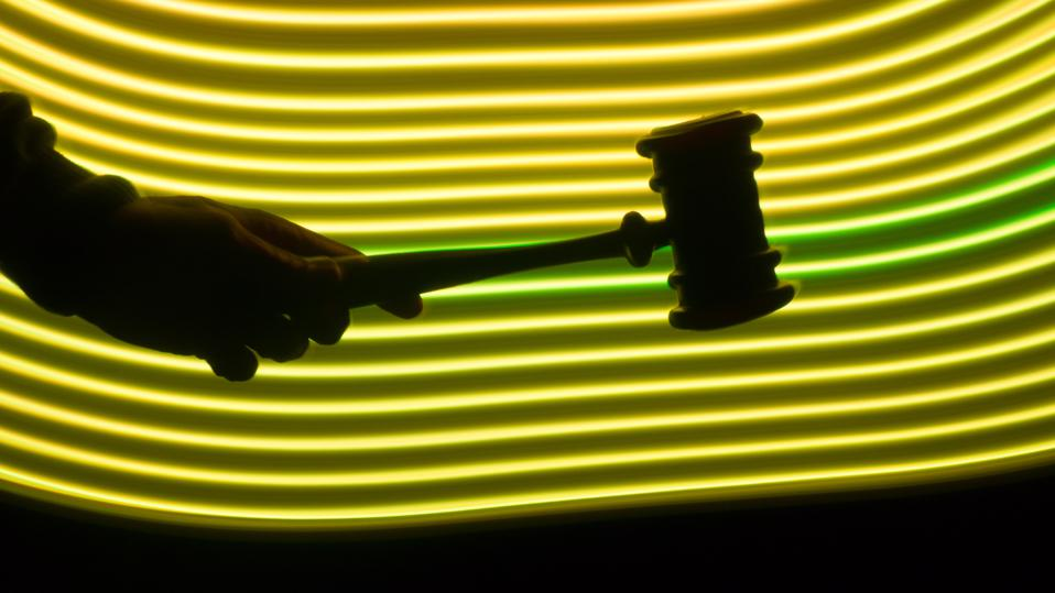 Judge's hammer in a futuristic yellow environment