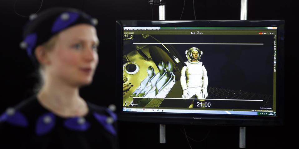 a computer-generated image of AFP journalist Helen Perceval (L) as she is filmed wearing a motion capture suit in a special effects studio