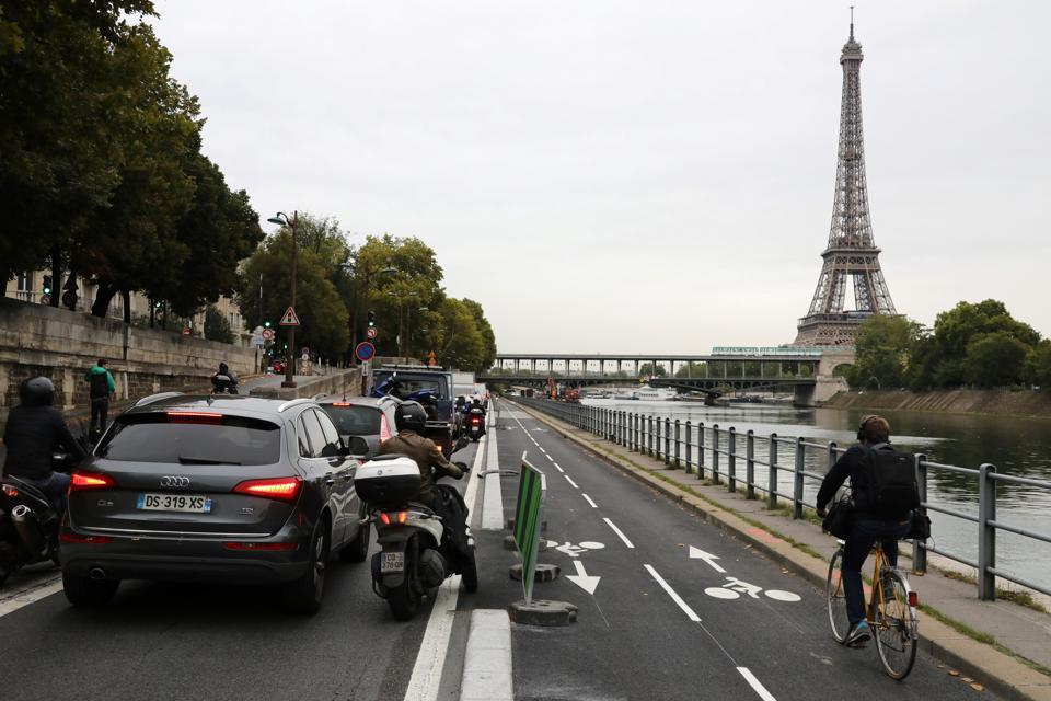 A bicyclist rides past the Eiffel tower in Paris