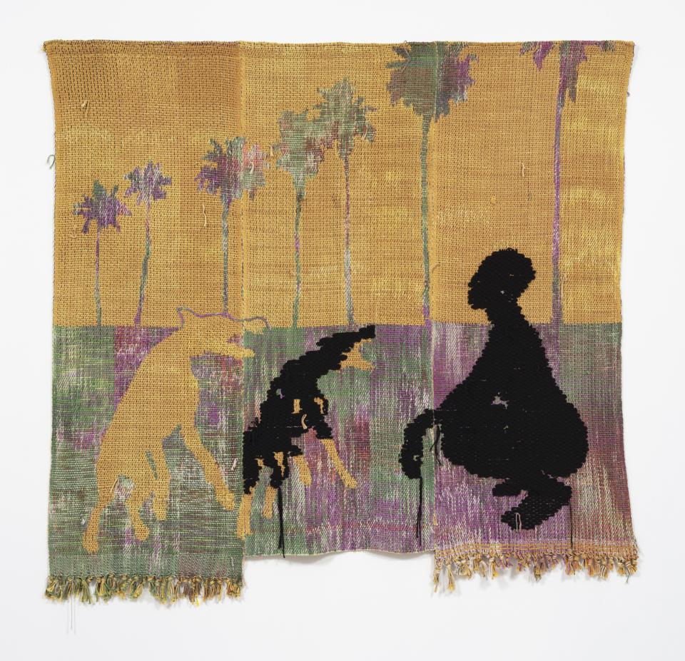 A tapestry by Diedrick Brackens that shows a man crouched besides two braying dogs.