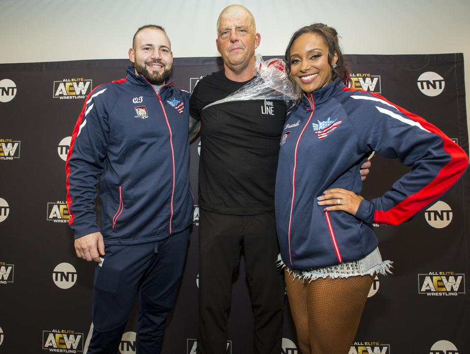 Brandi Rhodes (right) poses with QT Marshall (left) and Dustin Rhodes (center) following All Elite Wrestling's Revolution pay-per-view event. Saturday, February 29, 2020 at Wintrust Arena in Chicago, IL (Photo by Barry Brecheisen)