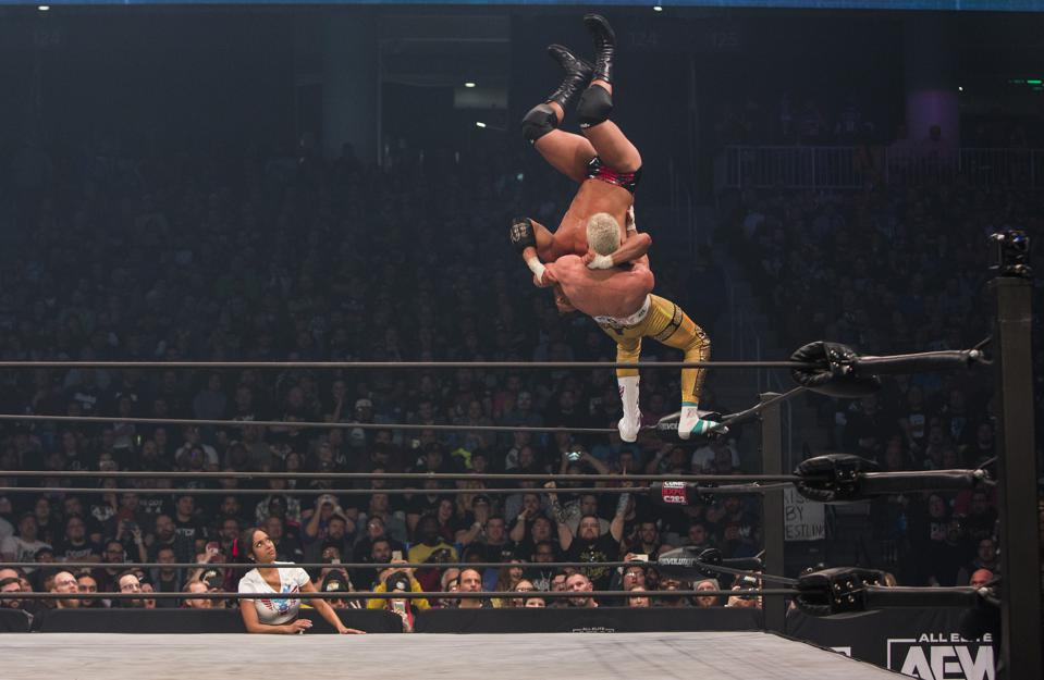 Cody superplexes MJF as Brandi Rhodes looks on during All Elite Wrestling's Revolution pay-per-view event. Saturday, February 29, 2020 at Wintrust Arena in Chicago, IL (Photo by Barry Brecheisen)