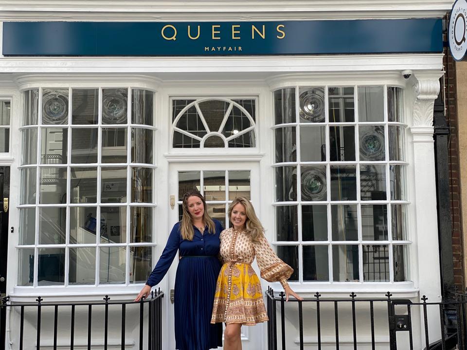 two women outside shop