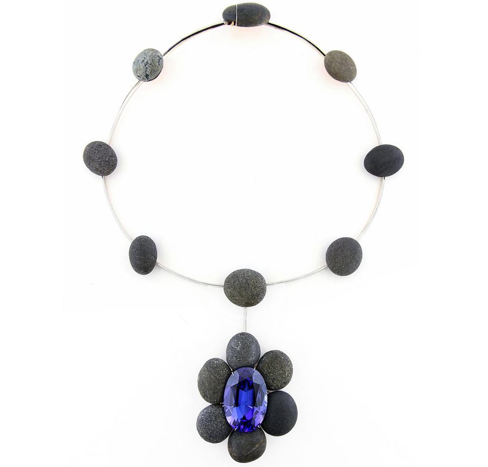 A necklace by Taffin with a 57.55-carat blue oval tanzanite and black pebbles