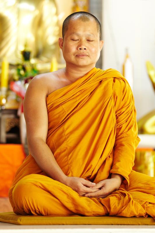 Meditating monk in a sacred shrine