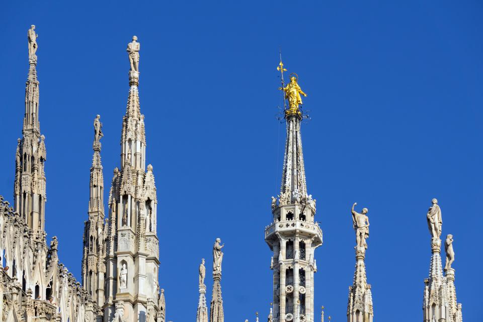 Italy. Lombardy. Milan. Spire of the Duomo and The Madonnina