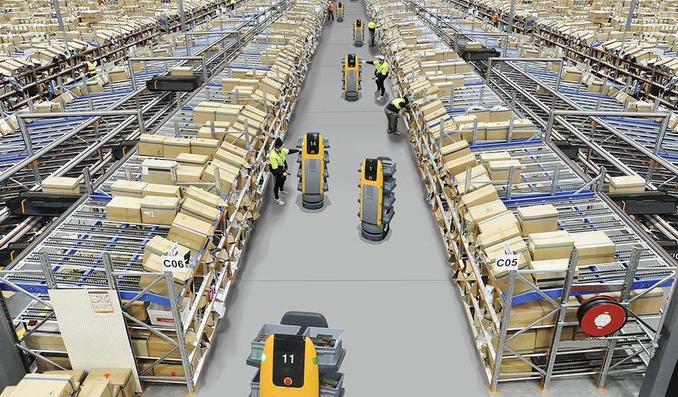 Operators work with AMRs in a warehouse to pick orders.
