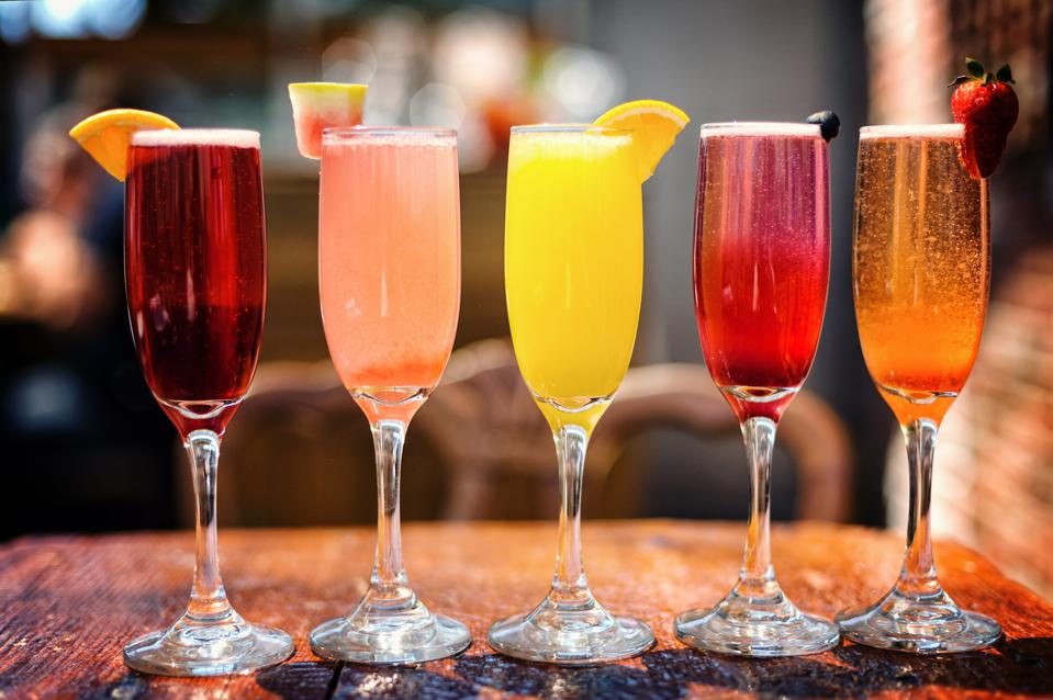 Assortment of Colorful Brunch Cocktails, Including Mimosas and Other Fruit Concoctions