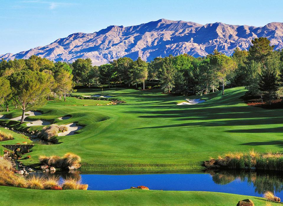Fairways, water, pines, mountains in the Mojave Desert at Shadow Creek Golf Resort.