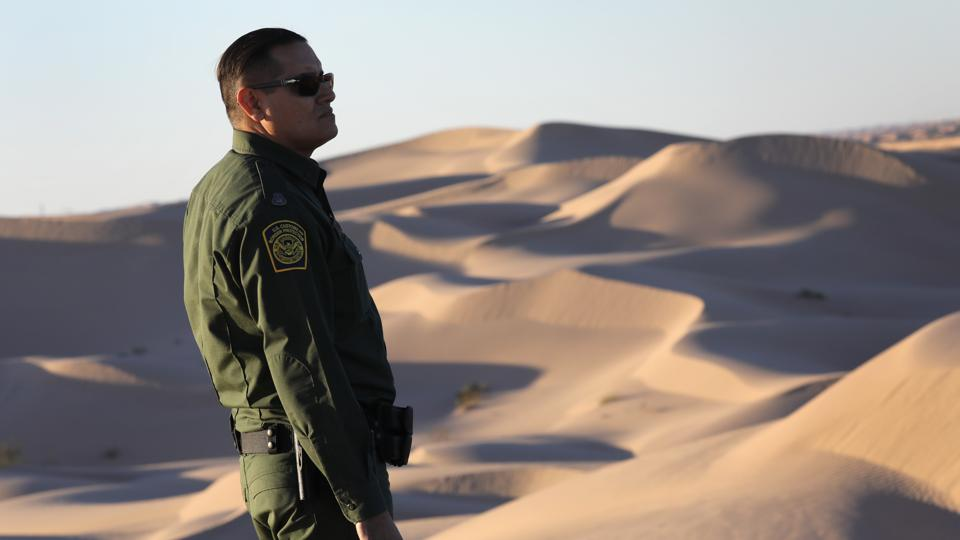 Border Patrol Agents Monitor Fence On U.S.-Mexico Border