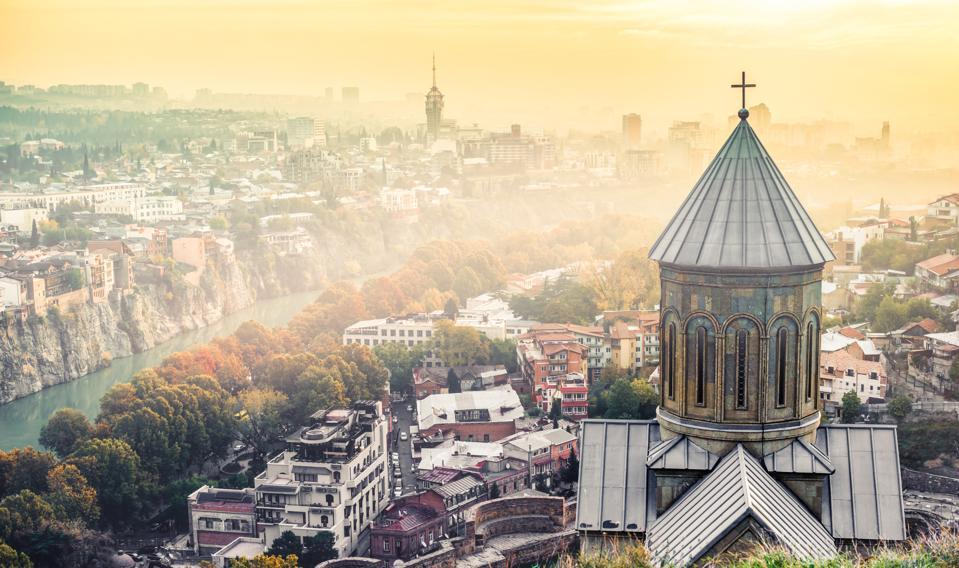 sunset view of Tbilisi and Saint Nicholas Church from Narikala F