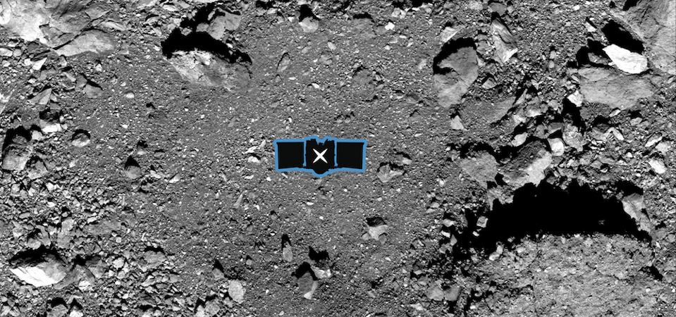 This image shows sample site Nightingale, OSIRIS-REx's primary sample collection site on asteroid Bennu. The image is overlaid with a graphic of the OSIRIS-REx spacecraft to illustrate the scale of the site.