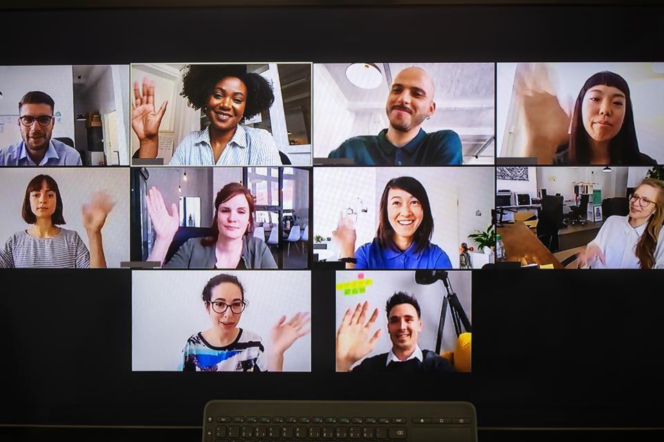 A business team having fun in a virtual meeting