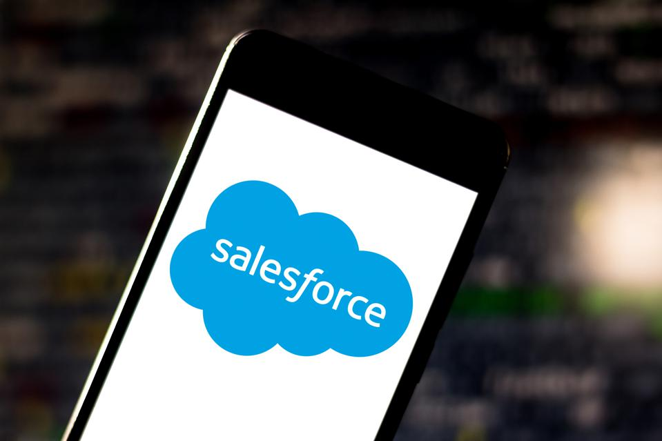 In this photo illustration a Salesforce logo is displayed on...