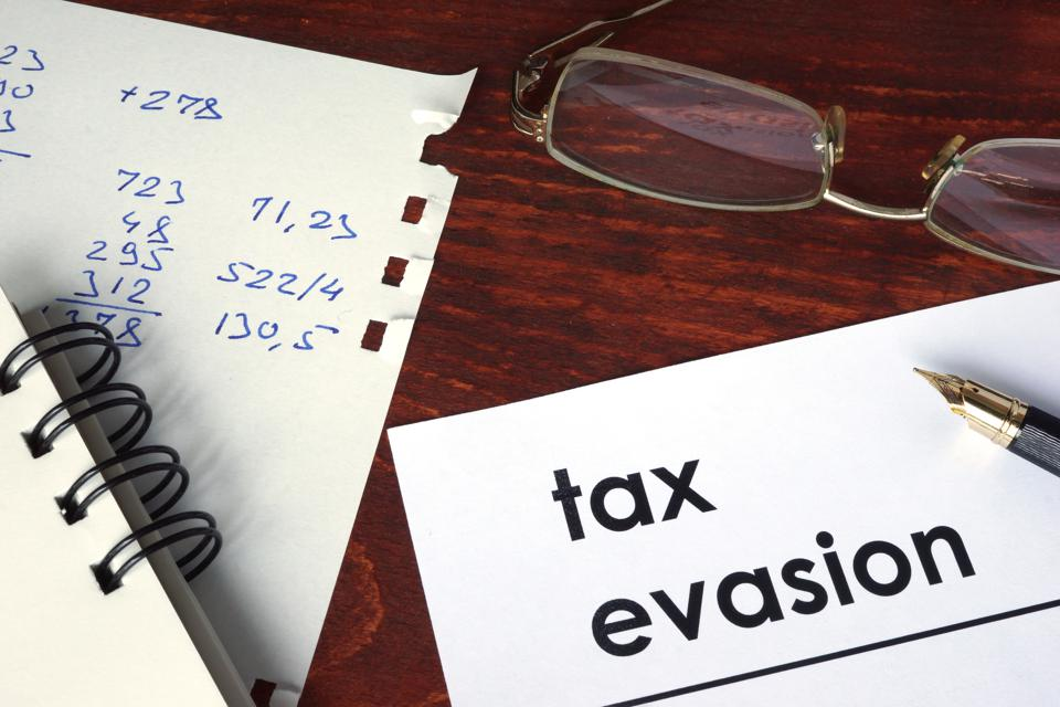 Tax evasion written on a paper.
