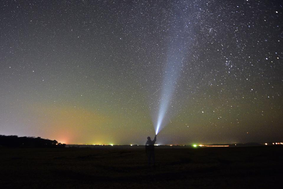 Halley's comet fragments, shining as Orionid meteors on Earth, are visible every October.