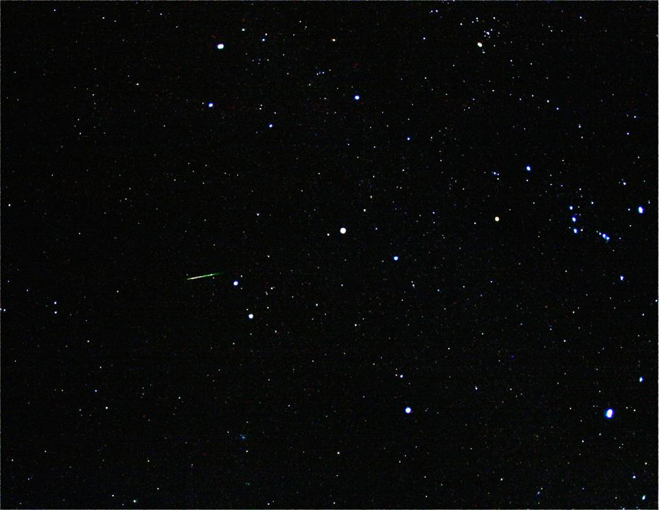 Here, a bright Orionid meteor can be seen radiating from the constellation of Orion.