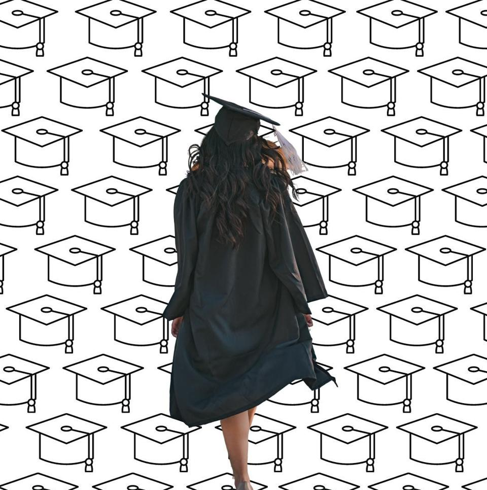 A graduate is turned walking into the distance.