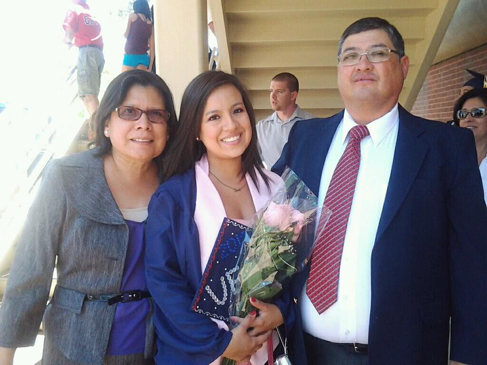 Picture of Author, Verónica Leyva, with her grandparents at graduation.