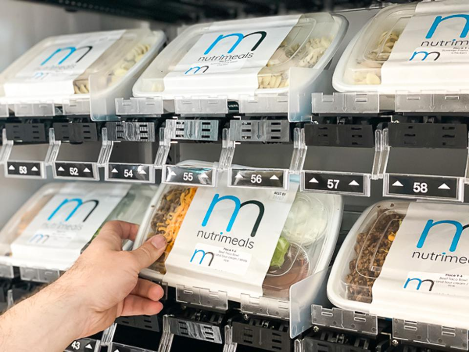 Ready meals being placed in a vending unit.
