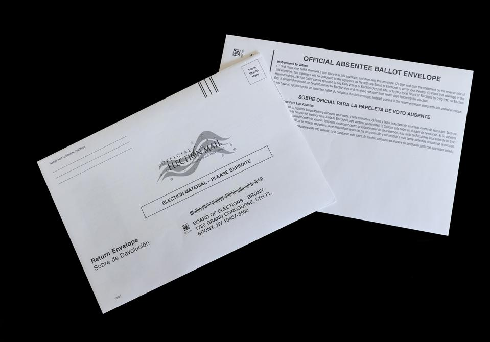 photo illustration of absentee mail-in ballot for...