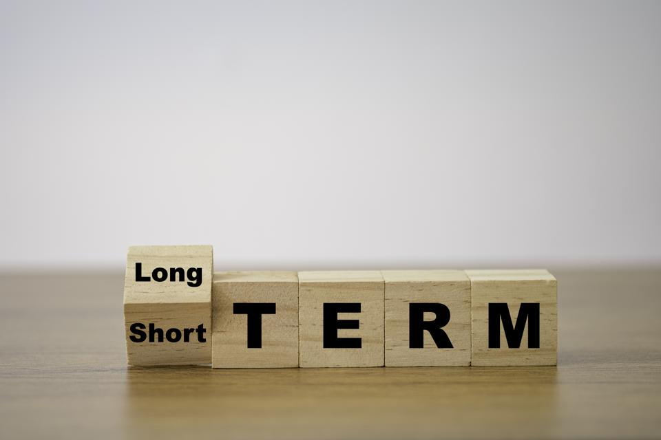 Wooden cube balancing short term and long term