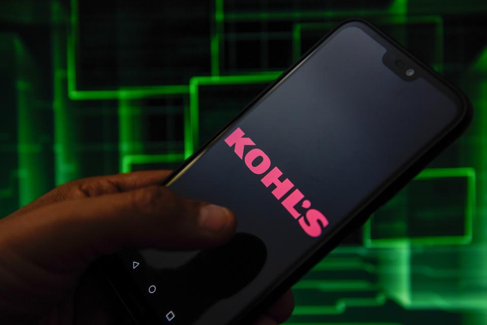 In this photo illustration a Kohls logo seen displayed on a...