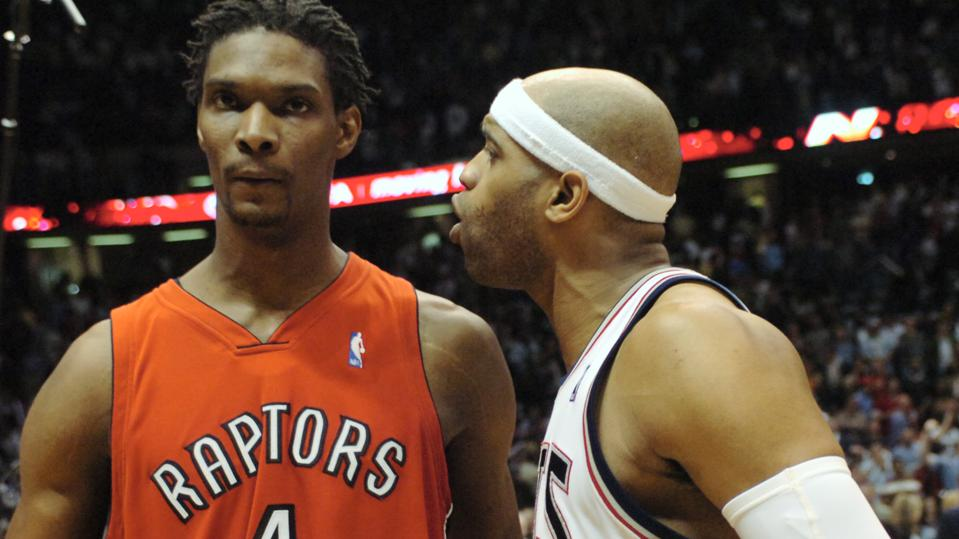 Raps V Nets - 05/04/07 - EAST RUTHERFORD, NEW JERSEY - Vince Carter speaks with Chris Bosh at the co