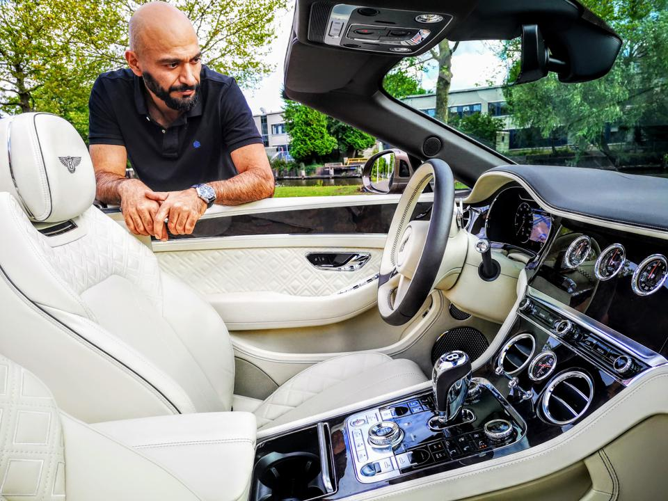 The interior of the Bentley Continental GT with beige and white interior