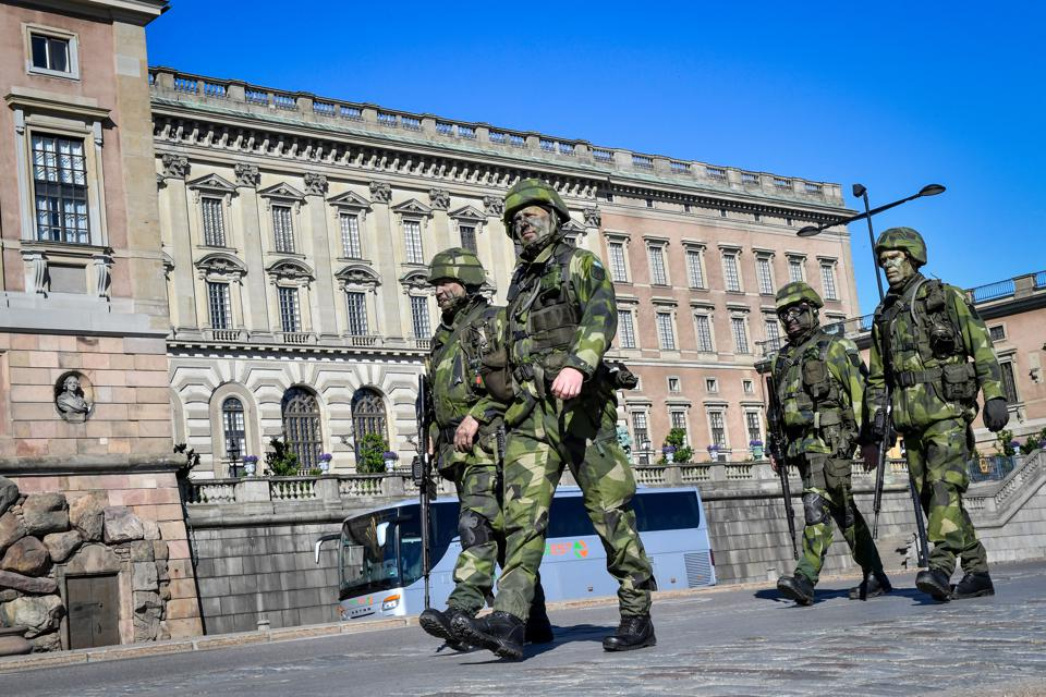Reservist soldiers march during a military training exercise in Stockholm, Sweden.