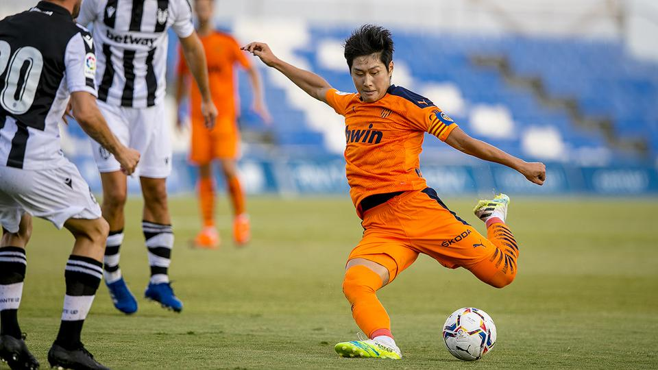 Kang-in Lee lines up a shot while playing a game for his club Valencia.